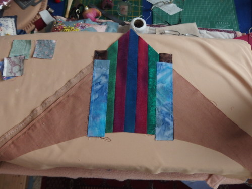 My centre is very ehavy due to all the extra seams  I have because of using up  old blocks for my circle shapes.  So I needed to make my corners heavy also to cope with the weight in the centre.  I cut out 4 corners from a good weight fabric then started sewing  1 1/2 inch strips