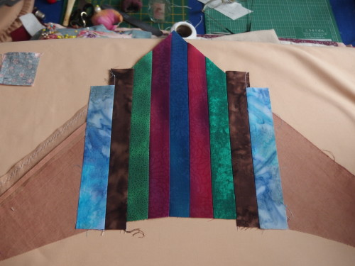 Adding two strips at a time using the same fabrics I used in my  centre star plus others from the same range.