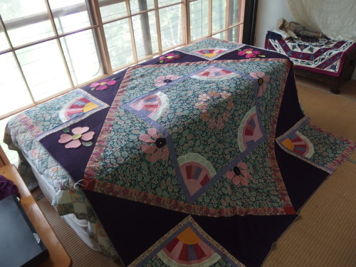 My Japanese quilt adding those large heart flowers on to the deep purple triangles.