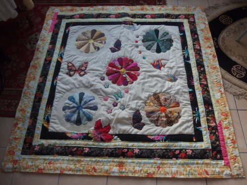 This was one of the first quilts I made. I was living in PNG and meeting up with a gr