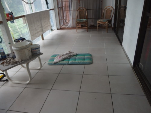 Tiles been laid over our wooden decking as it gets to much rain on it.
