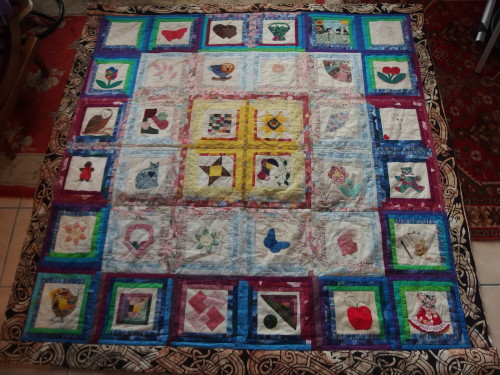 Papua New Guinea friend ship quilt we made these nearlly 20 years ago and Im just getting around to quilting it. As its all in blocks Im machine quilting it in the ditch,  sewing machines and I dont go together because I have a bad back so Im doing one or two runs a day, another few weeks and it will be done I hope.
