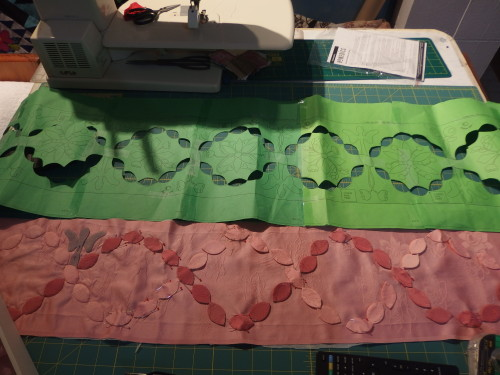So I made up a template in dark green paper so i could see the holes of the ovals clearly when I cut them all out, they were cut slightly small than the full size so my making lines will be covered by the ovals when appliquéd on.   I can not wash this quilt when it is finished so I ahve to be carful all the time to keep in clean and not show any marking. Its a nightmare I can tell you.