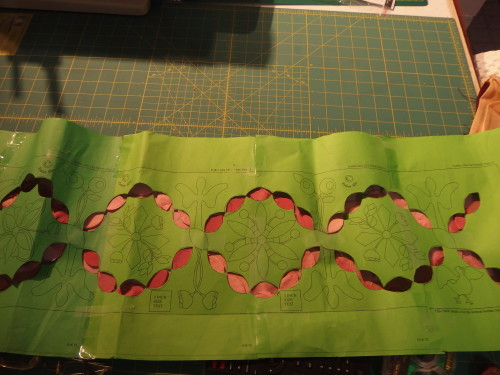 Here you can see the strong contrast where I have placed the template over my pink silk panel.  then I took a fine chalk marker and carefully marked only the ends of the ovals