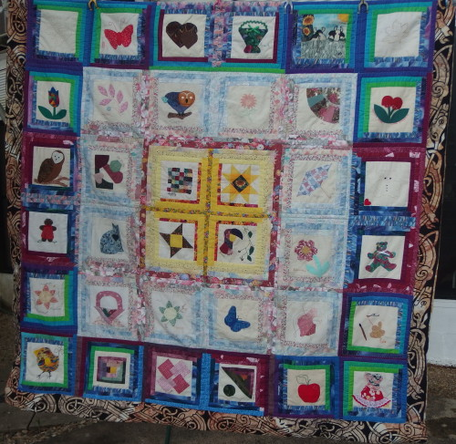Friendship quilt hanging out for some fresh air, Im about 1/2 way with the quilting.