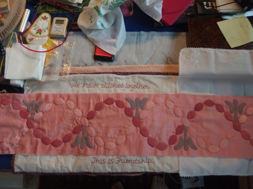 Slowly I'm getting to the end of this border sewing on my ovals or leaves as some call them.