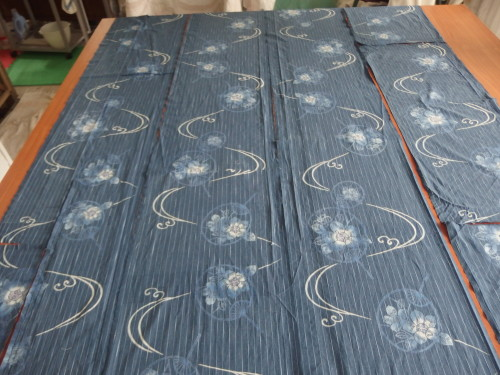 These panels are woven at 14inchs wide, and the design is set with a rice glue then dyed in indigo a long slow process but what a lovely soft soft look it gives.