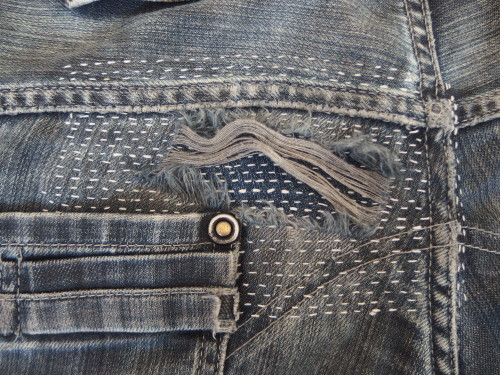 Patched jeans using sashiko stitching.