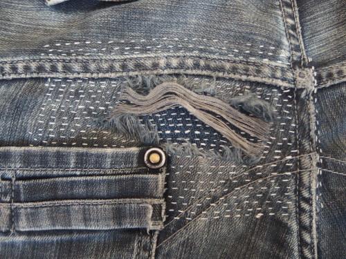 Patched jeans using sashiko stitching.