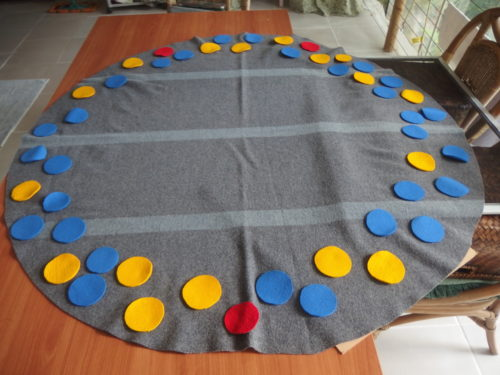 I was not happy with the shape of the blanket for the design I had been thinking of, so out came the scissors and I made a huge circle and started adding little circles.