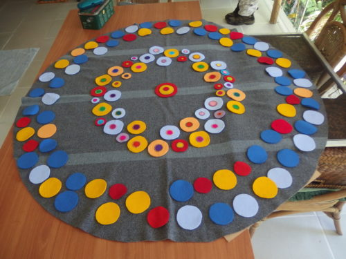 Im using very heavy wool felts for the big circles about 1/8th thick, I think it is going to be difficult to sew them to the rug, will try using a leather sewing needle first.