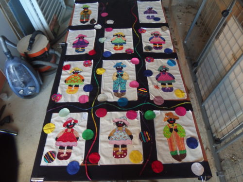Im not going to add Mummer Golly that I made here as it did not balance and I wanted to use every one of these a dorable blocks, I will make a cover for the quilt to go in and use Mumma on the cover. So Im leaving the top centre black black and will fill it with Balloons.
