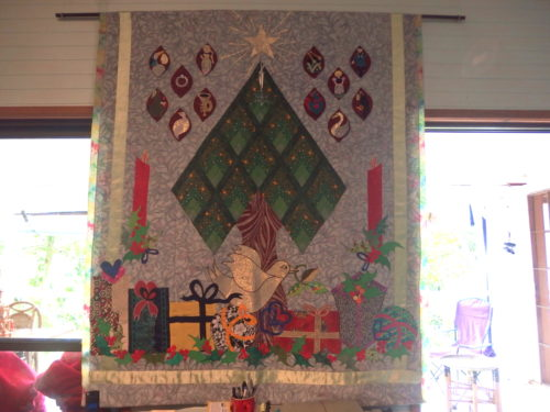 This wall quilt was designed by Esther Aliu several years ago it was a mystery BOM and all who made it had so much fun and ended up with a stunning Christmas wall hanging my family look forward to seeing it go up each year now.
