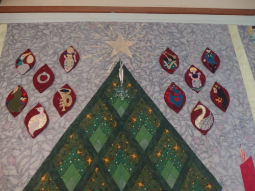 Its very cloudy out side at present so dark inside have taken a couple of close ups for those who want to have a good look LOL those 12 days before Christmas appliqués are free standing so can be removed if one ever wanted to wash the quilt.