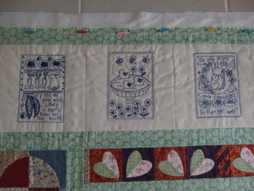 3 of the little Bluework blocks at the top of Sara's quilt.