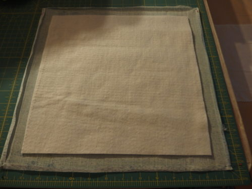 Have cut a 12inch square of wool batting and laid it on top of my backing.