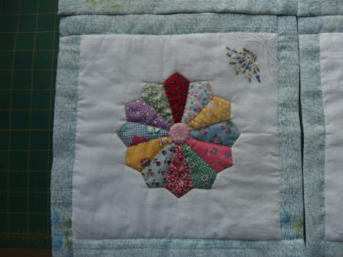 I also found time to appliuqe and quilt two more wee hanky QAYG blocks I find these so relaxing