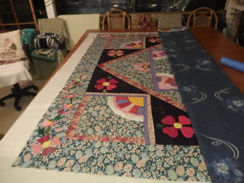 Ive completed basting the left hand side and now have turned the quilt around completely so