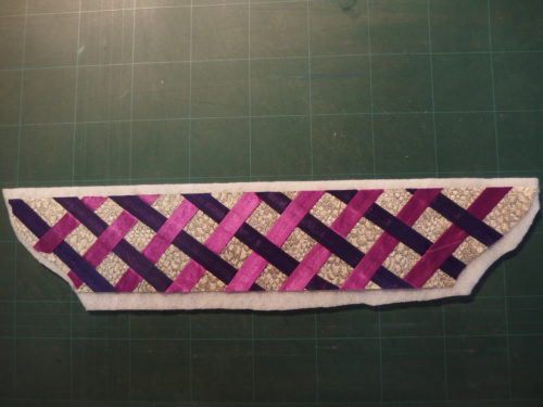 Ironed on to some batting before I quilt all those strips in place I want a 3D look as it looked rather flat.
