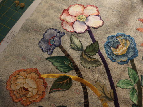 4 flowers embroidered and appliquéd down.