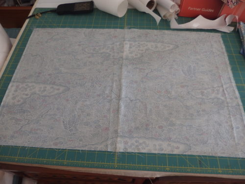To mark my background fabric I tape it down first then lay the patte on top