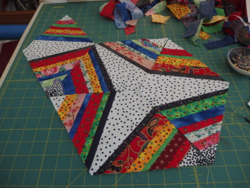 Just keep on adding triangles in to hexagons and then join hexagons up in to a quilt the size you want!!!!!