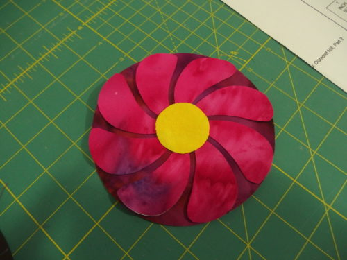 Large Lolly Pop flower, I cut out my back circle firs tthen cut my top petals all out of the one piece of fabric, both have iron on fusing behind them.