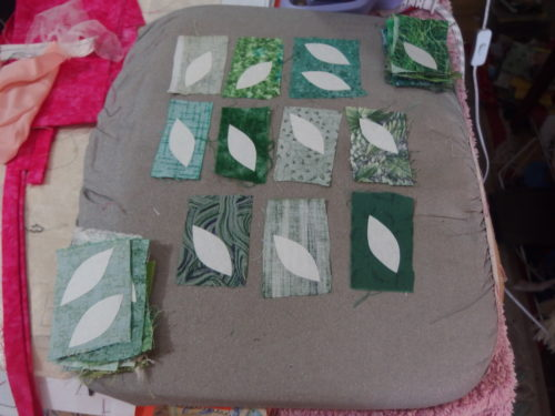 washaway freezer paper been ironed tot he abck of those wee pieces of fabric, I even managed to get two out out of a few pieces so have around 60 new leaves to baste. I have now 20 blocks completed, I need another 20 !!!!