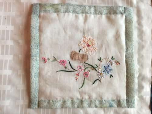 My first QAYG block using the beautiful embroidery I saved from a old table cloth .